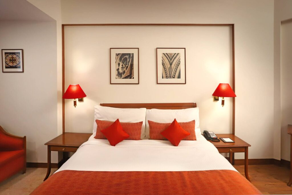 Deluxe Room Bed view - The Ambassador | Heritage Hotels in Mumbai, Aurangabad, Chennai - Deluxe Room
