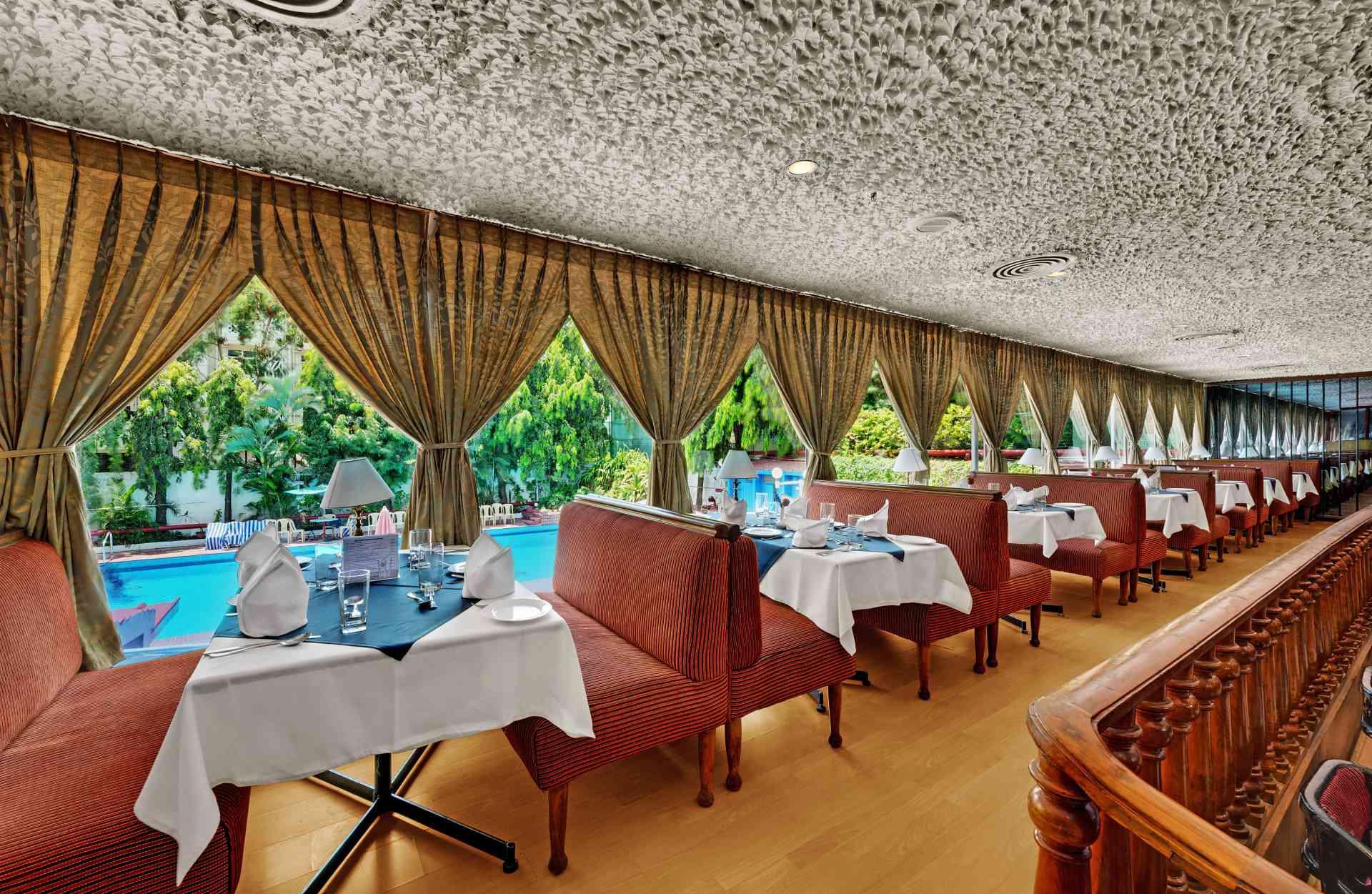 Chennai The Society Restaurant Pool View Ambassador Palava - The Ambassador | Heritage Hotels in Mumbai, Aurangabad, Chennai - Ambassador Pallava Chennai